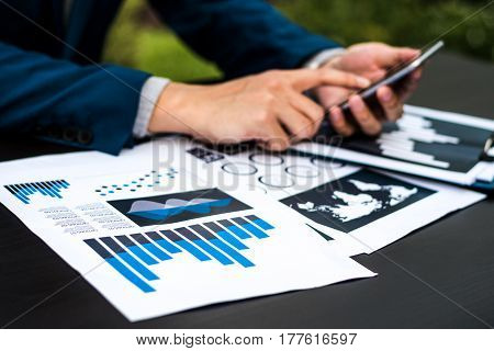 Handsome Businessman Wearing Suit And Using Modern Laptop Outdoors And Graph Finance Diagram