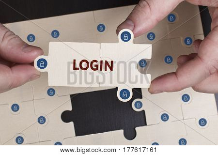 Business, Technology, Internet And Network Concept. Young Businessman Shows The Word: Login