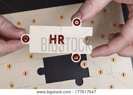 Business, Technology, Internet And Network Concept. Young Businessman Shows The Word: Hr