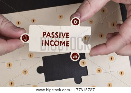 Business, Technology, Internet And Network Concept. Young Businessman Shows The Word: Passive Income