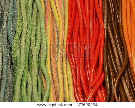 Madrid (Spain): colorful strips of licorice in the shop window of Plaza Mayor