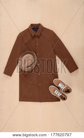 men's Coat clothes with hat,shoe –wooden background