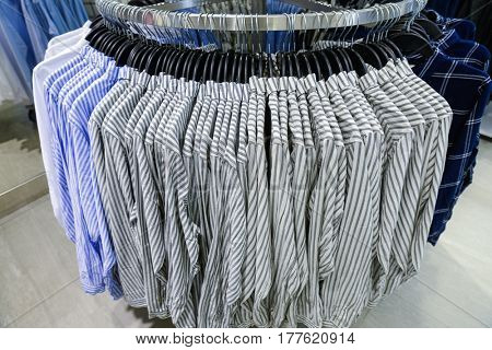 Set of man suit ,Shirts on hangers at shop
