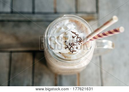 Chocolate Smoothie (milkshake)  In Retro Glass Jar (mason Jar), Pink Straw And Candy On Wooden Table