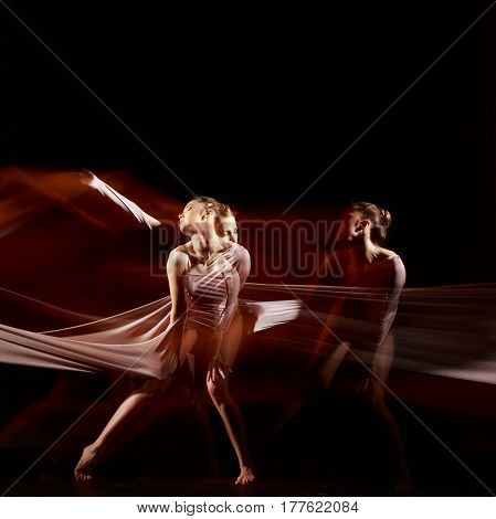 The sensual and emotional dance of beautiful ballerina with hammock fabric . Photography technique with strobe