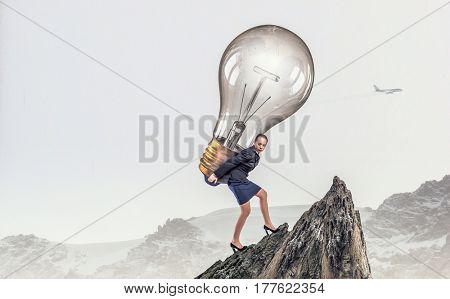 Carrying her big idea . Mixed media