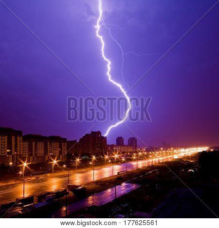Amazing lightning and thunderstorm above night city