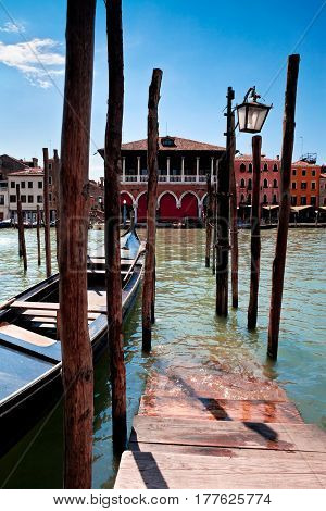 View of parking place for Gondolas in Venice on Grand canal Italy