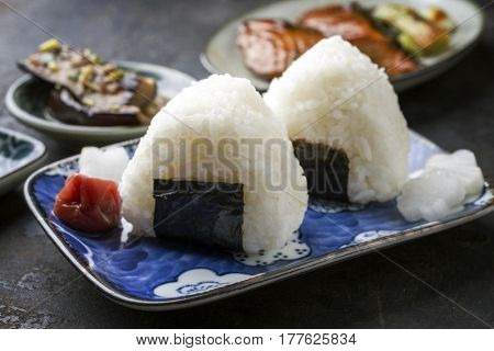 Traditional Japanese Onigiri with Umeboshi as garnish on a bowl