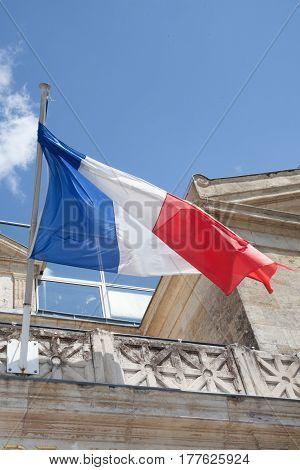 French Flag Floats In The Sky In Front Of The Town Hall
