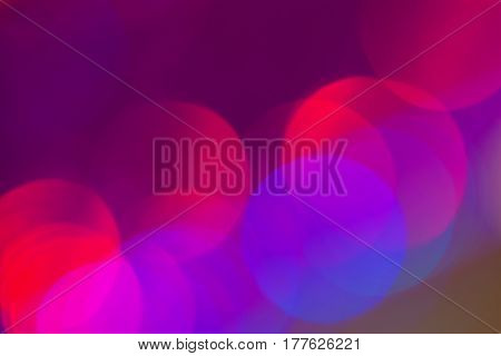 Abstract background of large bokeh lights circles on purple background. Defocused lights. For modern dark background, backdrop, substrate, composition use, copy space, all occasions, especially holiday