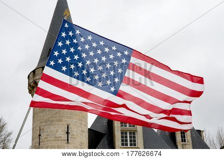 In Front Of A Beautiful Castle The American Flag Floats In The Sky,