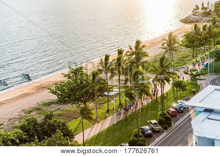 Townsville Australia - January 16 2017: Many people having fun running and jogging on The Strand at sunrise.