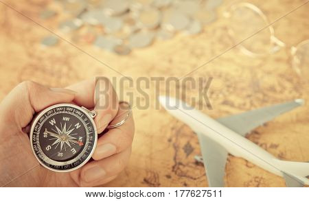 Compass and traveler equipment on vintage map with copy space