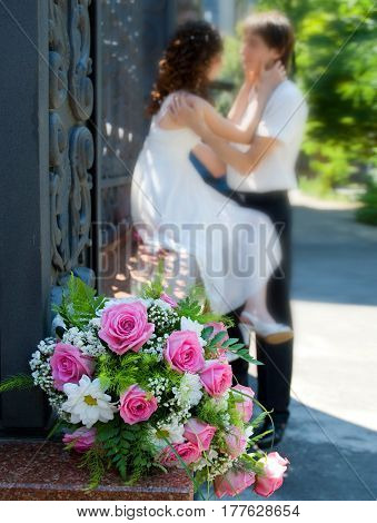 Bride groom and wedding bouquet. Sharpness on the bouquet. Shallow depth of field