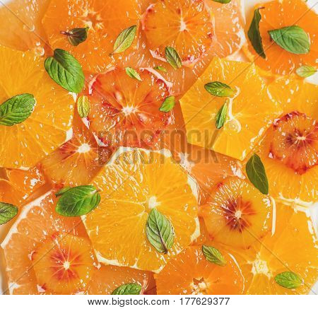 Fresh mixed citrus fruit salad with mint and honey, top view, close-up. Vegan, vegetarian, healthy, dieting, detox food, clean eating concept