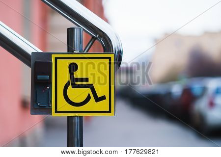 the sign for the disabled on the handrail.