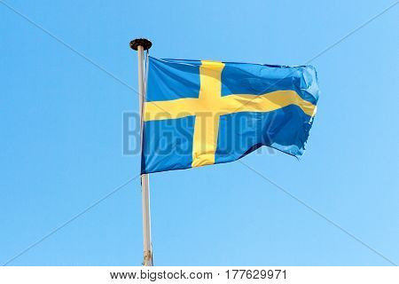 Flag Of Sweden In The Wind And A Blue Sky