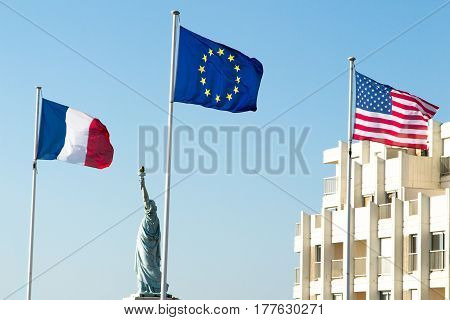 French, European And American Flags Under Blue Sky