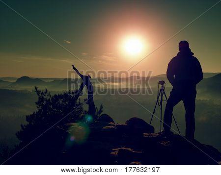 Photographer On Peak Of Rock. Fall Fogy Landscape