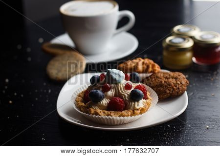 sweet cake with cup of tea isolated on white.