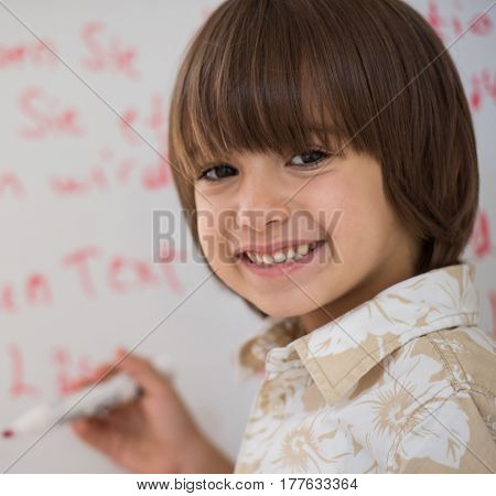 Kid writing on white board