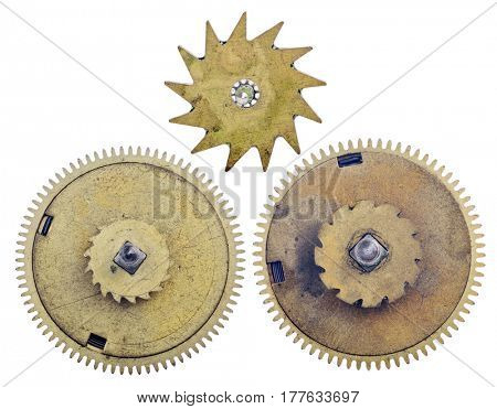 three old brass gears isolated on white background