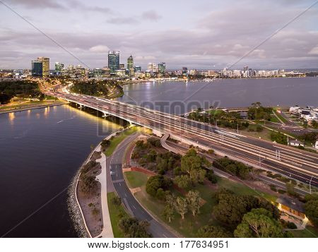 Aerial photograph of Perth city, Western Australia, looking across the Swan River from South Perth on dusk.