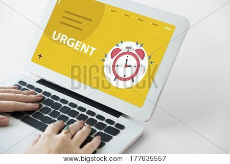hands with illustration of alarm clock notification for important appointment on laptop