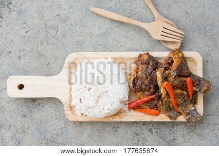 Tilapia fish with topped spicy sour chili served with steamed rice Thai styel food