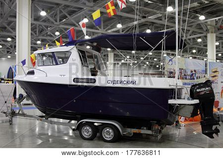 MOSCOW - MARCH 09 2017: Boat VYMPEL 7000 for 10 International boat show in Moscow. Russia.