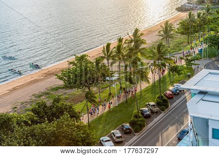 Townsville Australia - January 16 2017: Many people having fun running and jogging on The Strand at sunrise while others enjoy paddling.