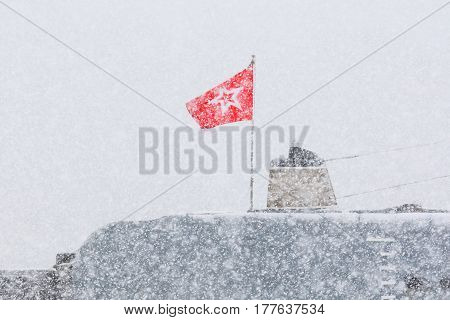 Russian submarine.Blizzard.A red flag with a star aboard a military submarine.