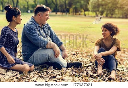 Group of Diverse People Talking Together at Park