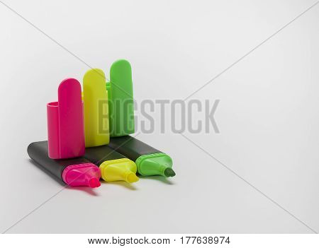 Stationery colored markers as a traffic light close-up isolate