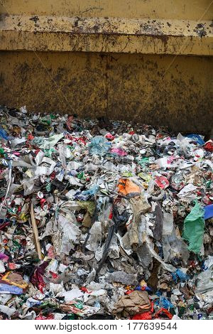Pile of mixed waste at the dumpsite storage in a treatment plant. Waste disposal collection separation management and treatment concept.