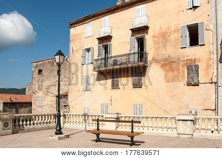 A typical Corsican building on the square in Sartene, Corsica Island, France