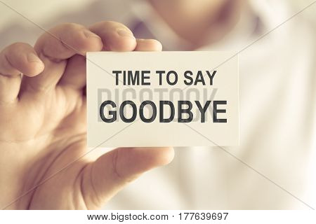Businessman Holding Time To Say Goodbye Message Card