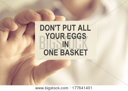 Businessman Holding Do Not Put All Your Eggs In One Basket Message Card