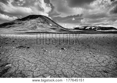 Patternd ground with polygons in beautiful primordial icelandic highland on a clear sunny day with blue sky and white clouds. Kaldidalur, Iceland. Monochrome.