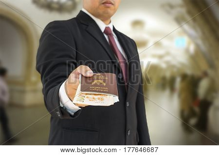 businessman give a passport to you for travel russia in moscow - can use to display or montage on product