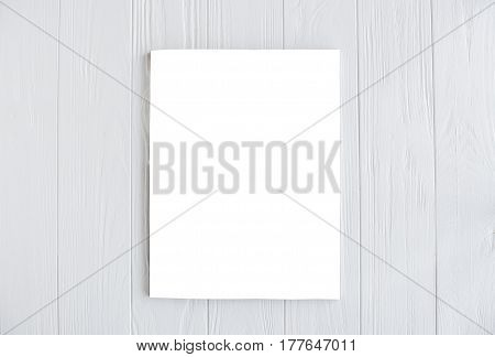 White isolated magazine cover mock-up on white wooden table board background