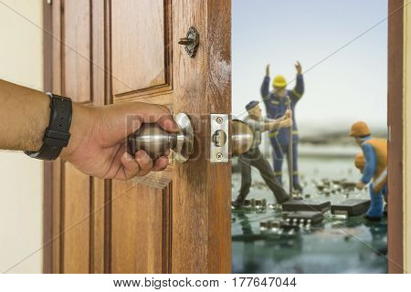 abstract scene of man open the wood door to mini worker repair mainboard - can use to display or montage on product