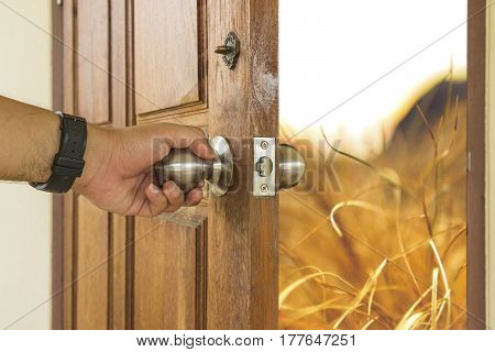 abstract scene of man open the wood door to vintage landscape - can use to display or montage on product