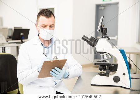 Chemist Working With A Microscope