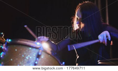 Passionate girl with long hair - percussion drummer perform music break down - teen rock music, telephoto