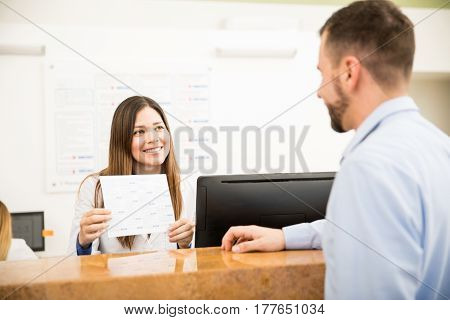 Receptionist Showing Services And Costs