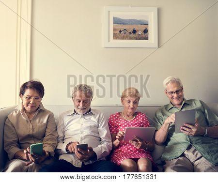 Senior Adult Use Tablet Mobile Phone Technology