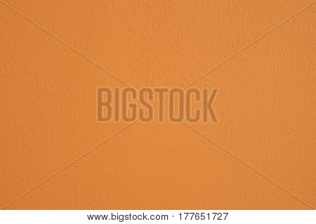 Concrete beige painted wall as a textured background
