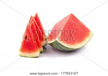 Ripe watermelon and watermelon sliced on a white background.